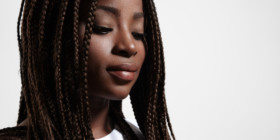 Two black students at a Massachusetts charter school have been punished for wearing braided hair extensions. Parents and civil rights lawyers say the school's hair and makeup code disproportionately affects students of color.